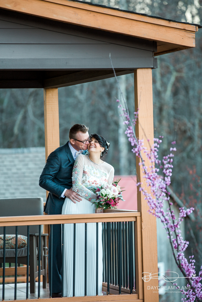deck wedding kiss